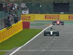 Lewis Hamilton braccato da Vettel per tutto il GP. Afp
