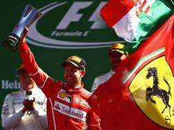 Sebastian Vettel sul podio di Monza. Getty