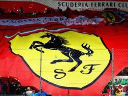 I tifosi della Ferrari in tribuna centrale a Monza. Getty