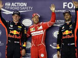 Sebastian Vettel tra Verstappen e Ricciardo. Getty