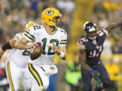 4 TD pass per Rodgers contro Chicago. Reuters