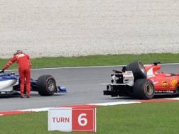 La Ferrari di Vettel dopo l'incidente a Sepang. Afp