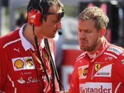 Sebastian Vettel scuro in volto dopo il ritiro a Suzuka. Epa