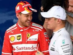 Vettel e Bottas dopo le qualifiche. Afp