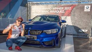 Marc Marquez, 24 anni, davanti alla  BMW M4 CS, il premio per aver vinto la classifica delle pole