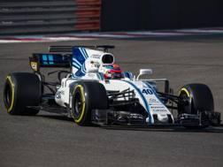 Robert Kubica in azione con la Williams ad Abu Dhabi. Pellegrini