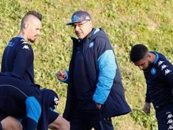 Marek Hamsik, Maurizio Sarri e Lorenzo Insigne alla vigilia della sfida interna contro lo Shakhtar. AFP