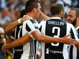 Mario Mandzukic, Giorgio Chiellini e Gonzalo Higuain. REUTERS
