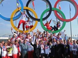 È il 24 febbraio 2014: Putin a Sochi festeggia con gli atleti russi il successo nel medagliere. Ap