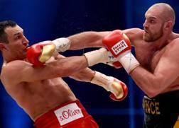 Tyson Fury (a sinistra), 29 anni GETTY