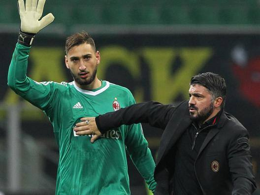 Rino Gattuso, 39 anni, con Gigio Donnarumma, 18. Getty