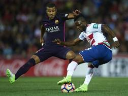 Rafinha,m a sinistra, qui contro Henry Agbo . Getty