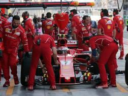 Si lavora attorno alla vettura di Kimi Raikkonen. LaPresse