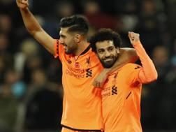 Emre Can (24) esulta con Mohamed Salah (25). AP