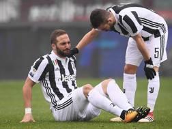 Higuain, dolorante per la botta alla caviglia rimediata nel derby. Afp