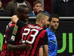 Adel Taarabt e Mario Balotelli ; con Pazzini match-winner di Milan-Livorno. Afp