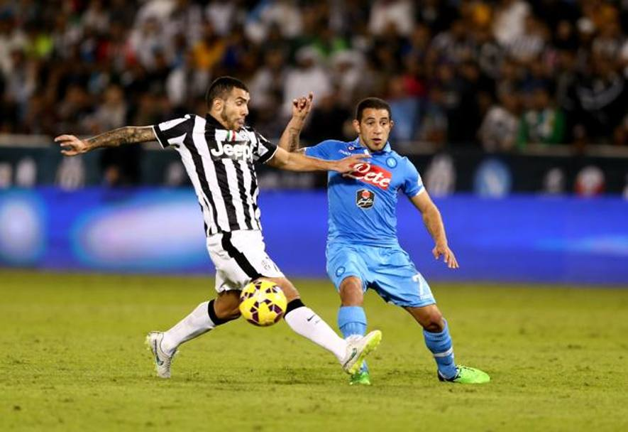 Tevez e Gargano. Getty Images