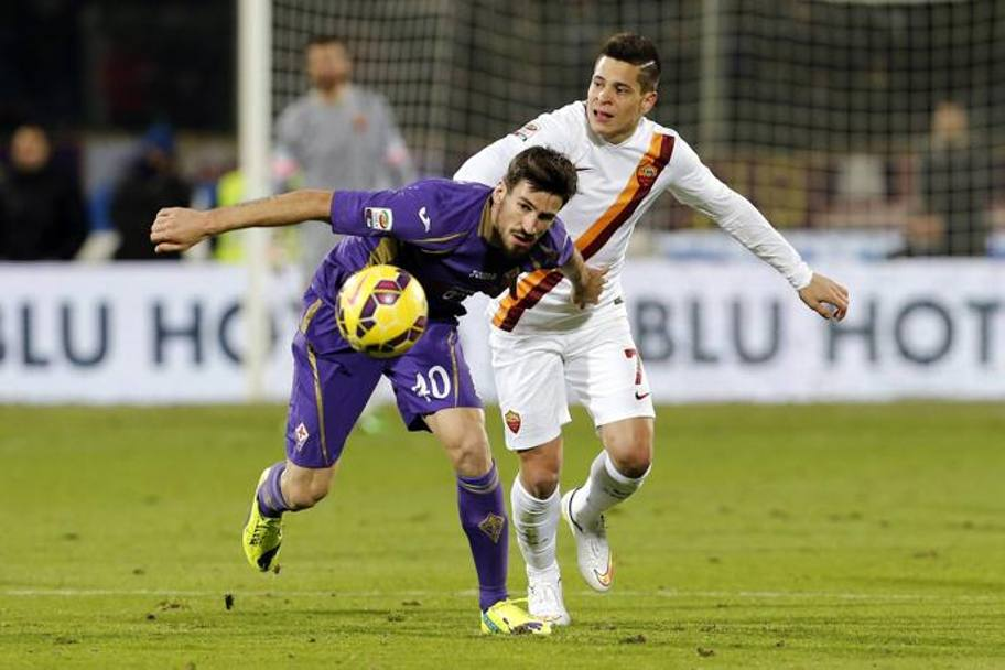 Tomovic contro Iturbe. Action Images
