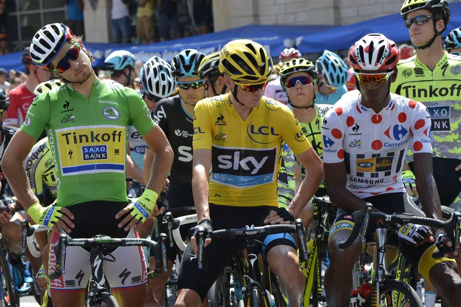 Tre maglie; Sagan in verde, Froome in giallo, Teklehaimanot a pois. Afp