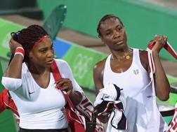 Le sorelle Williams amare dopo il clamoroso k.o. Afp