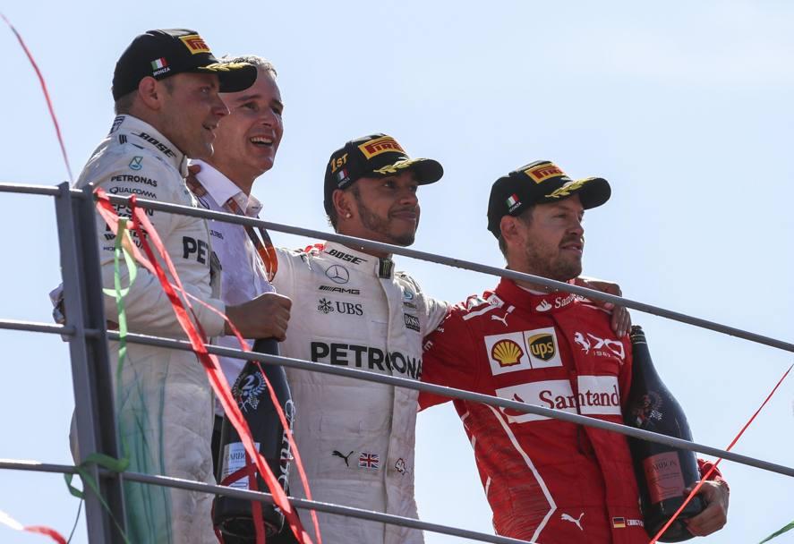 I tre piloti sul podio del Gran Premio d'Italia di Formula 1. Foto: EPA.