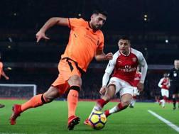 Emre Can in azione contro l'Arsenal. Getty
