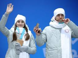 Alexander Krushelnytsky insieme alla moglie Anastasia Bryzgalovoy sul podio. Getty