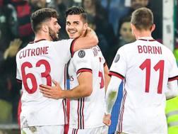 Patrick Cutrone e André Silva, attaccanti del  Milan, festeggiano sotto gli occhi di Fabio Borini. Ansa