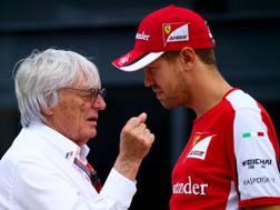 Bernie Ecclestone con Sebastian Vettel. Getty