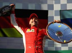 Sebastian Vettel felice dopo la vittoria. Getty