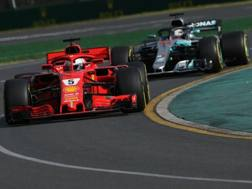 La Ferrari di Vettel davanti alla Mercedes di Hamilton. Lapresse