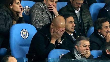 Josep Guardiola in tribuna dopo essere stato allontano dal campo durante il match contro il Liverpool. Epa