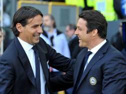 Il tecnico della Lazio Simone Inzaghi e l'allenatore dell'Udinese Massimo Oddo. LaPresse