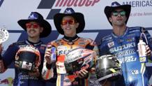 Marc Marquez felice sul podio di Austin tra Viñales e Iannone. Ap