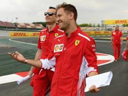 Vettel sorride in ricognizione sulla pista di Montmelo. Getty