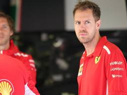 Sebastian Vettel ai box della Ferrari. Lapresse
