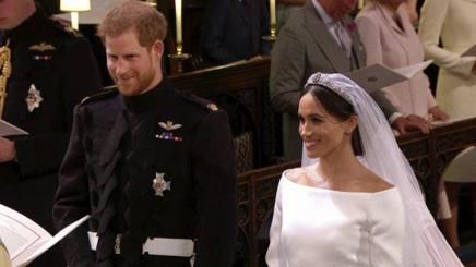 Il principe Harry, 33 anni, e Meghan Markle, 36, all'altare. Ap