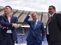 I dirigenti del Milan, Han Li, Marco Fassone e Massimiliano Mirabelli. LaPresse