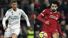 Il fuoriclasse del Real Cristiano Ronaldo,33 anni, e la stella del Liverpool Momo Salah, 25. Afp