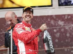 Sebastian Vettel sul podio di Monaco. Epa