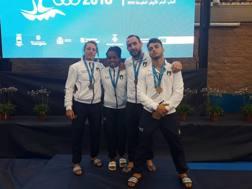 Da sinistra: Paissoni, Gwend, Mungai e Basile con le medaglie vinte a Tarragona