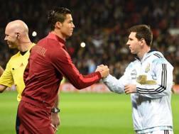 Cristiano Ronaldo e Messi con le rispettive nazionali Lapresse