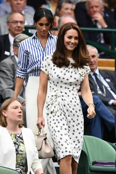 Kate sorride entrando nel Royal Box con la cognata Meghan, amica di Serena Williams