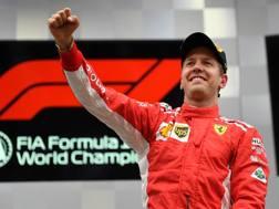 Sebastian Vettel esulta sul podio di Spa. Getty