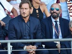 Totti e Monchi al seguito della Roma. Ansa