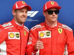 Sebastian Vettel e Kimi Raikkonen, dopo la qualifica di Monza. Ansa