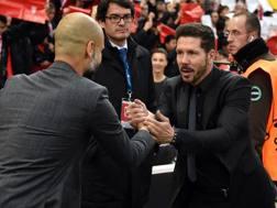 Pep Guardiola e Diego Simeone. Afp