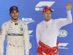 Lewis Hamilton e Sebastian Vettel. Ap