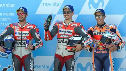 Da sinistra Dovizioso, Lorenzo e Marquez. Afp