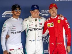 Hamilton, Bottas e Vettel dopo la qualifica a Sochi. Epa